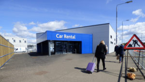 Car rental agency building and lot